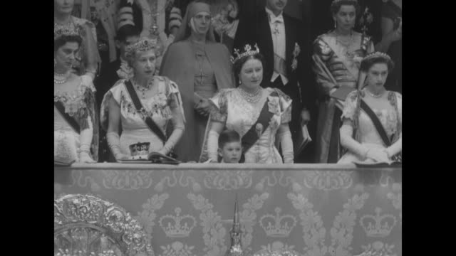 the raised canopy held by 4 knights of the garter is held in place as the archbishop of canterbury anoints the queen / queen mother prince charles... - coronation stock videos and b-roll footage