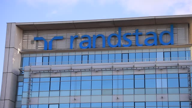 stockvideo's en b-roll-footage met the randstad company logo on the facade of the french head office on december 4 in saint-denis, france. dutch multinational human resource consulting... - rubriekadvertentie