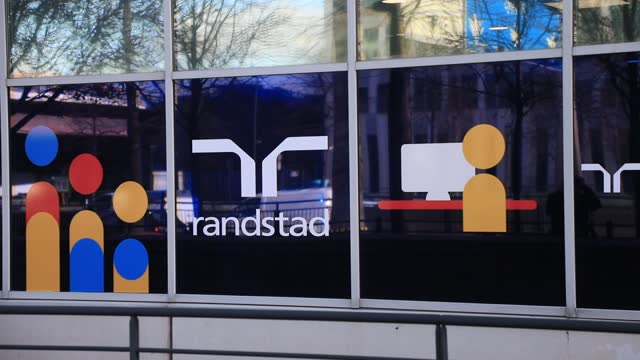 the randstad company logo on the facade of the french head office on december 4 in saint-denis, france. dutch multinational human resource consulting... - クラシファイド広告点の映像素材/bロール