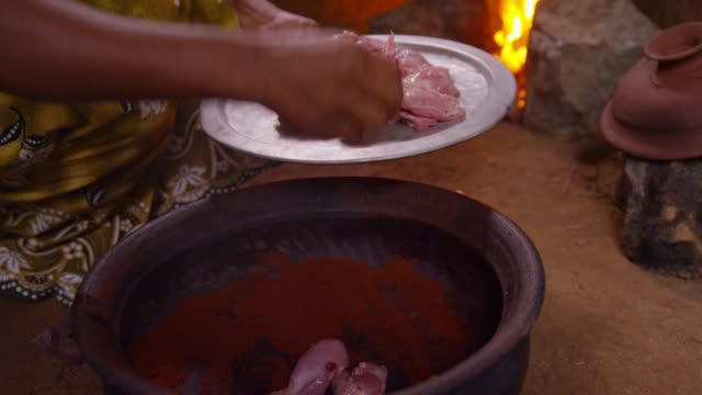 the raw chicken into the pan - being fired stock videos & royalty-free footage