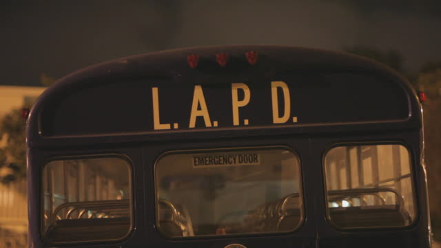 CU of the rear entrance of a LAPD bus Night