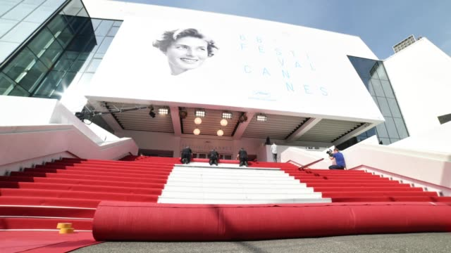 the red carpet being rolled out at general views on may 12, 2015 in cannes, france. - カンヌ映画祭点の映像素材/bロール