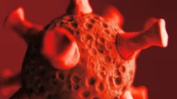 The red coronavirus rotates in a blurry motion