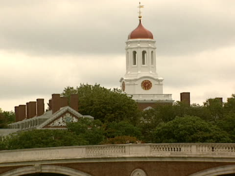 the red tower of harvard's kennedy school of government rises above the weeks bridge over the charles river - harvard bridge stock videos & royalty-free footage