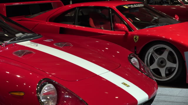 the red vehicles are a main attraction in the exotic transportation hall the event is canada's largest automotive show held annually at the metro... - transportation event stock videos and b-roll footage