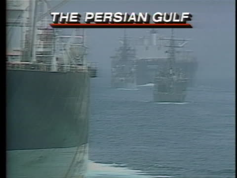 the re-flagged kuwaiti tanker, the bridgeton, and its escort of united states naval ships rest in the persian gulf as their request for mine sweeping... - request stock videos & royalty-free footage