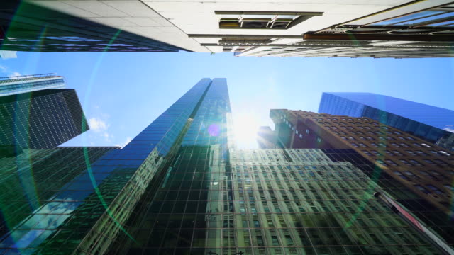 The reflected sunlight illuminates rows of high-rise buildings at Midtown Manhattan New York City.