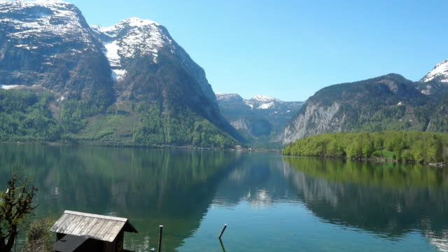 The reflection of Hallstatter see lake at Hallstatt, view from Obertraun Austria at summer