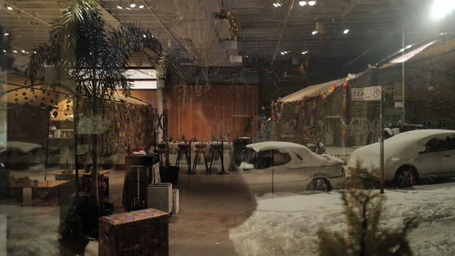 the reflections of snow covered parked cars outside overlay themselves on the empty and closed interior of a tiki themed restaurant in greenpoint,... - digital composite stock videos & royalty-free footage