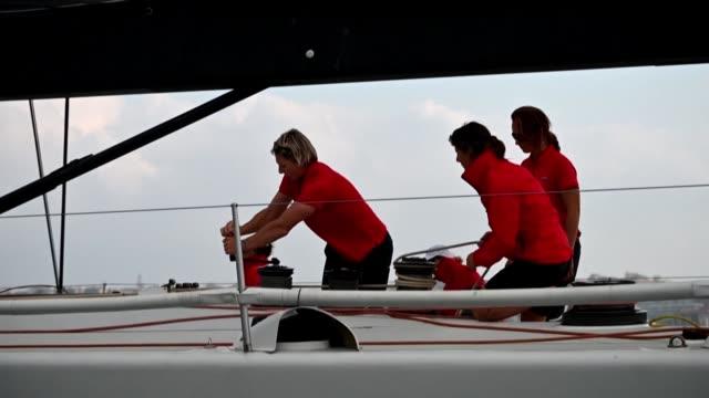 vídeos y material grabado en eventos de stock de the regatta boat golfo di trieste with an all international female crew from seven countries sails ahead of the world's largest regatta the barcolana - equipo de vela
