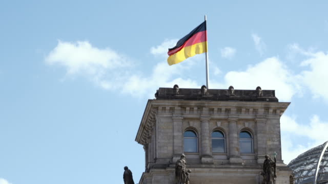 the reichstag with german flag - german flag stock videos & royalty-free footage