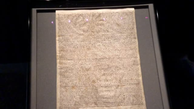 vídeos de stock e filmes b-roll de the reinstalled original magna carta inside the medieval chapter house at salisbury cathedral, where it was attacked and had to be removed. - magna carta documento histórico