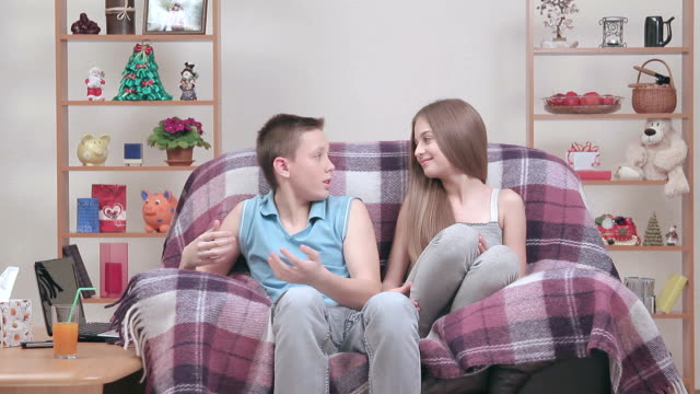 the relationships between teenagers resting in armchair indoors. - 14 15 years stock videos and b-roll footage