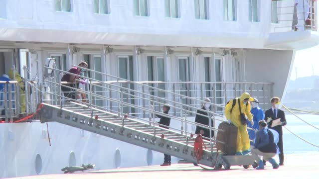 the remaining crew of a coronavirus-hit cruise ship that spent more than six weeks stranded off the coast of uruguay disembark and are to be... - evacuation stock videos & royalty-free footage