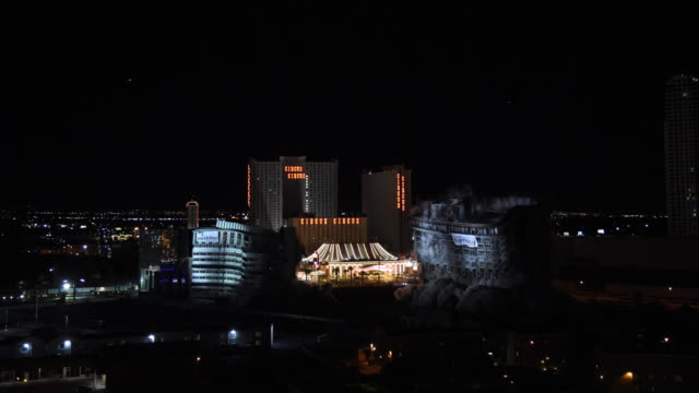 The remaining structures of the shuttered Riviera Hotel Casino including the 22story Monte Carlo tower are imploded on August 16 2016 in Las Vegas...