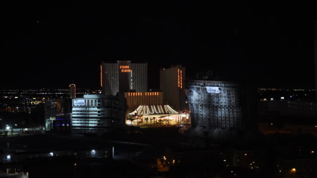 the remaining structures of the shuttered riviera hotel casino including the 22story monte carlo tower are imploded on august 16 2016 in las vegas... - imploding stock videos and b-roll footage