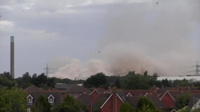 stockvideo's en b-roll-footage met the remains of a coalfired power station where four workers were killed when it collapsed several years ago are demolished cooling towers at the... - oxfordshire