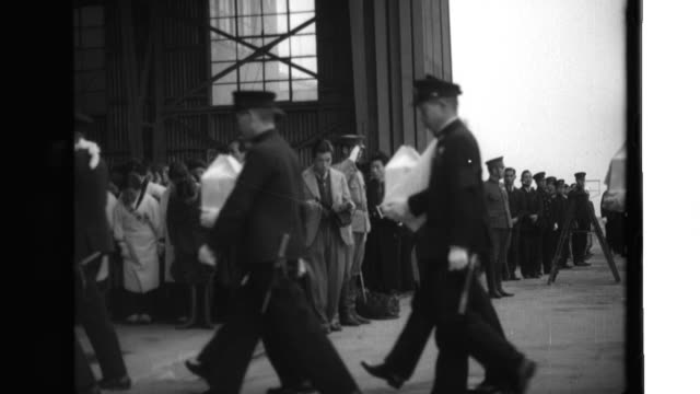 the remains of japanese admiral mineo ohsumi arrive in haneda aboard a naval aircraft and are placed on a temporary altar; minister of the navy... - widow stock videos & royalty-free footage