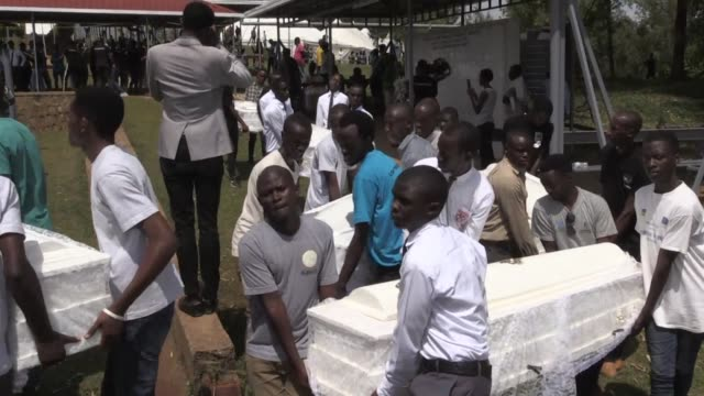 the remains of nearly 85000 people murdered in rwanda's genocide were laid to rest in a sombre ceremony in kigali a quarter century after the... - völkermord stock-videos und b-roll-filmmaterial