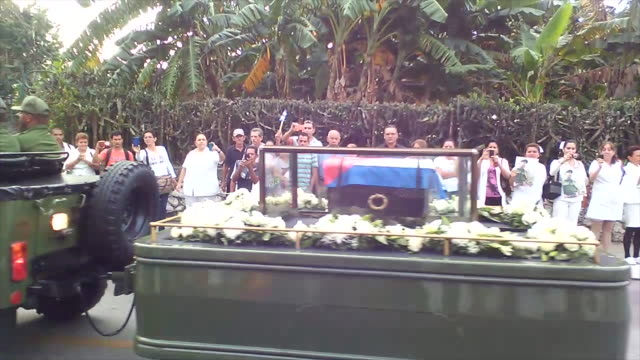 The remains of Revolutionary leader Fidel Castro pass the city where people gather to give the last good bye
