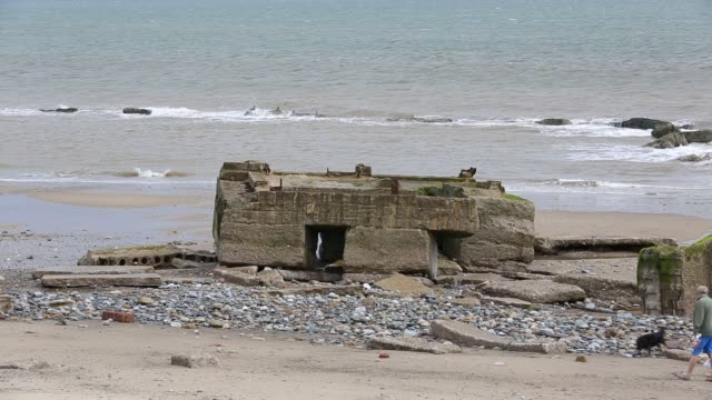 the remains of the godwin battery on the beach at kilnsea at the head of spurn point on yorkshires east coast, uk. initially constructed during the first world war, the godwin battery was added to during the second world war. it comprised of gun emplaceme - weathered stock videos & royalty-free footage