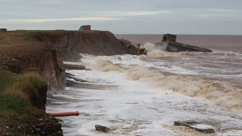 the remains of the godwin battery on the beach at kilnsea at the head of spurn point on yorkshires east coast, uk. initially constructed during the... - eroded stock videos & royalty-free footage