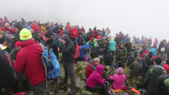 the remembrance day gathering on the summit of great gable in the lake district to remember those members of the fell abd rock club who died in the first world war. - remembrance day stock videos and b-roll footage