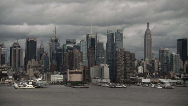 the reminisce of hurricane irene brush past the city.  it's a cloudy and new york skyline - sequential series stock videos & royalty-free footage