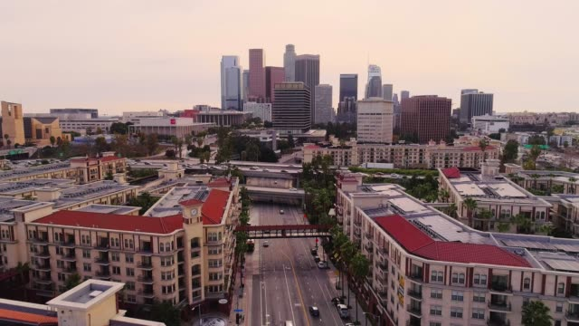 the remote aerial view of the downtown los angeles over the residential district - financial district stock videos & royalty-free footage