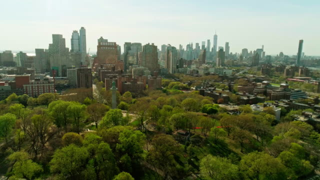 the remote aerial view toward the manhattan downtown financial district from brooklyn, over the residential district and the fort green park - tree fort stock videos & royalty-free footage