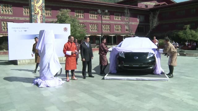 the remote himalayan kingdom of bhutan signed a deal with japanese auto giant nissan friday to become the ultimate showcase for electric cars taking... - thimphu stock videos & royalty-free footage