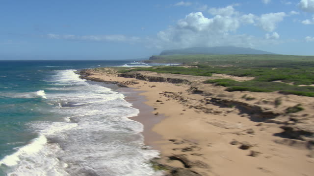 The remote, sandy shore of Kalani Beach on the northwest coast of Hawaii's Molokai island.