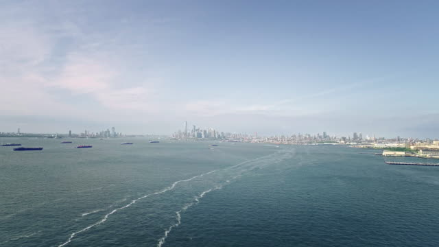 the remote scenic aerial view to manhattan skyline with the freedom tower and the many ships on anchorage from verrazano-narrows bridge, brooklyn, new york. - staten island stock videos and b-roll footage