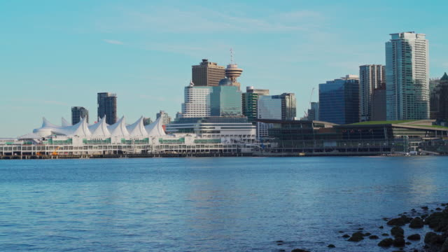 the remote view to canada place ferry terminal in vancouver downtown from stanley park across vancouver harbor. - ferry terminal stock videos & royalty-free footage