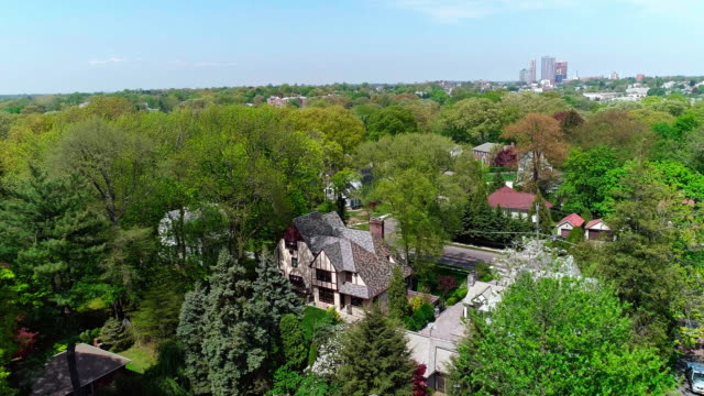 the remote view to the downtown of new rochelle over the residential district of the pelham manor, westchester county. - new england usa stock videos & royalty-free footage