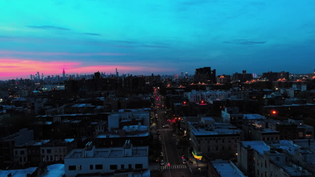 the remote view to the manhattan downtown from brooklyn, over the residential district. - dusk stock videos & royalty-free footage
