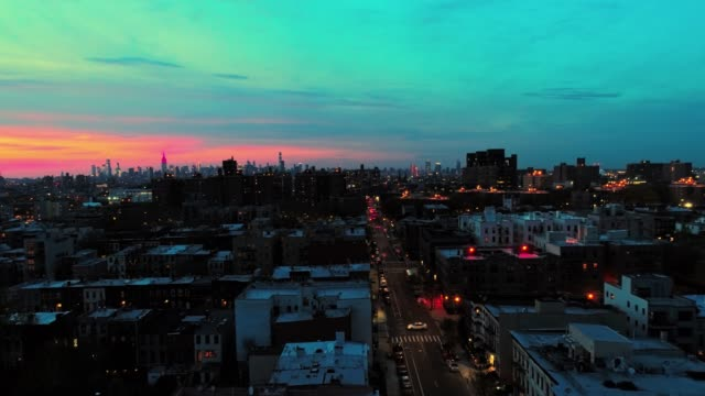 the remote view to the manhattan downtown from brooklyn, over the residential district. - nightlife stock videos & royalty-free footage