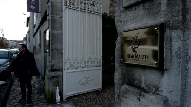 The Remy Martin company name stands on a wall outside the Remy Cointreau SA headquarters in Cognac France on Friday Dec 9 Barrels of Remy Martin...