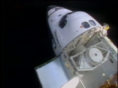 the repaired hubble space telescope prepares for release into space from the space shuttle discovery. - discovery stock videos & royalty-free footage