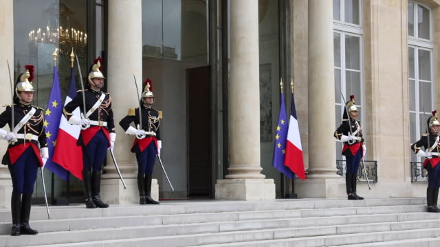 the republican guard stands at attention in the courtyard of the elysee palace, where french president emmanuel macron is due to welcome swedish... - prime minister stock-videos und b-roll-filmmaterial