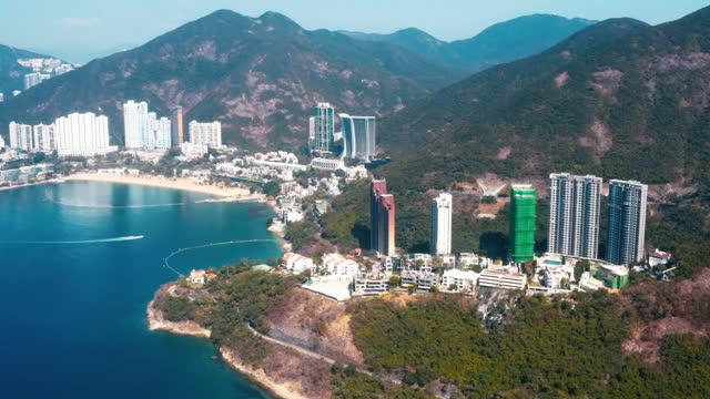 stockvideo's en b-roll-footage met de afstotende baai aan de zuidoostkust van het eiland hong kong. hongkong - zuid