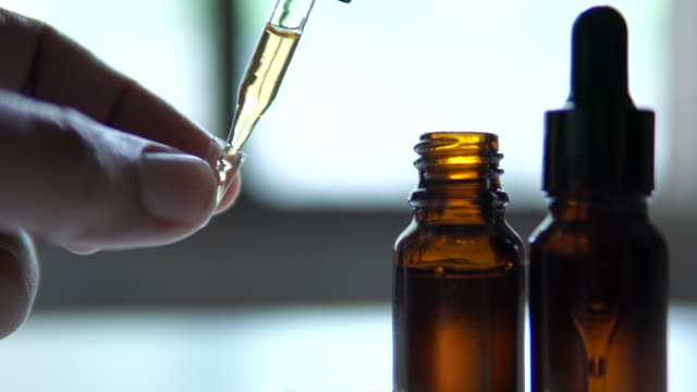 the researchers packed hemp oil in capsules to treat cancer patients - marijuana herbal cannabis stock videos & royalty-free footage