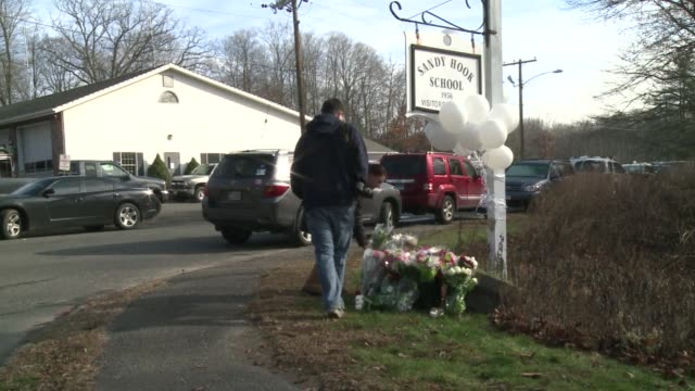 the residents of an idyllic connecticut town were reeling in horror saturday from the massacre of 20 small children and six adults in one of the... - newtown connecticut stock videos & royalty-free footage