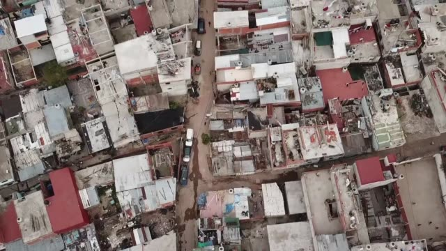 the residents of argentina's zavaleta a poor neighborhood in buenos aires crippled by drug gangs and addicts were already struggling even before the... - buenos aires stock videos & royalty-free footage
