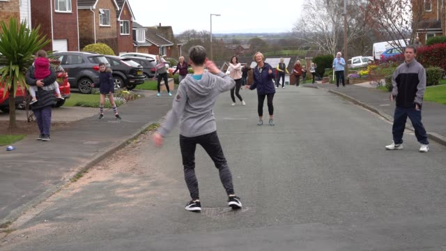 the residents of springbourne in frodsham cheshire take part in their daily social distance dancing and fitness event led by resident janet woodcock... - dancing stock videos & royalty-free footage