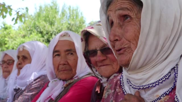 the residents of the dodurga district of the seydikemer neighborhood in turkey's southwestern muğla province continue to daily life among the ruins... - senior women stock videos & royalty-free footage
