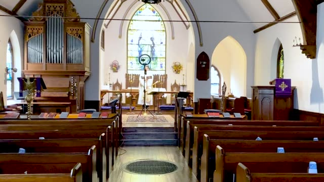 the rev. philip dinwiddie pre-records mass at st. james episcopal church in grosse ile, michigan on april 24, 2020. due to the covid-19 pandemic,... - church stock videos & royalty-free footage