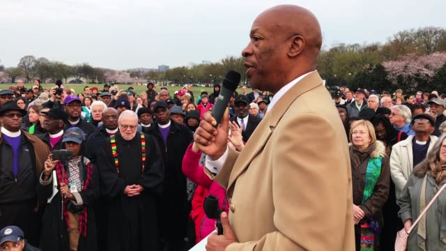 the reverend dr toussaint king hill jr addresses fellow faith leaders as they prepare for a silent march from the dr martin luther king jr memorial... - martin luther religious leader stock videos & royalty-free footage
