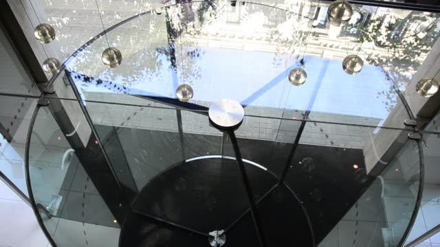 the revolving door at a modern hotel. - 1920x1080 - revolving door stock videos & royalty-free footage