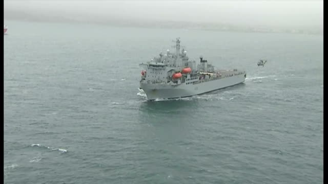 the rfa argus departs falmouth for sierra leone. shows exterior shots aerials rfa argus moving along sea. on october 17, 2014 in falmouth, england. - 英国海兵隊点の映像素材/bロール